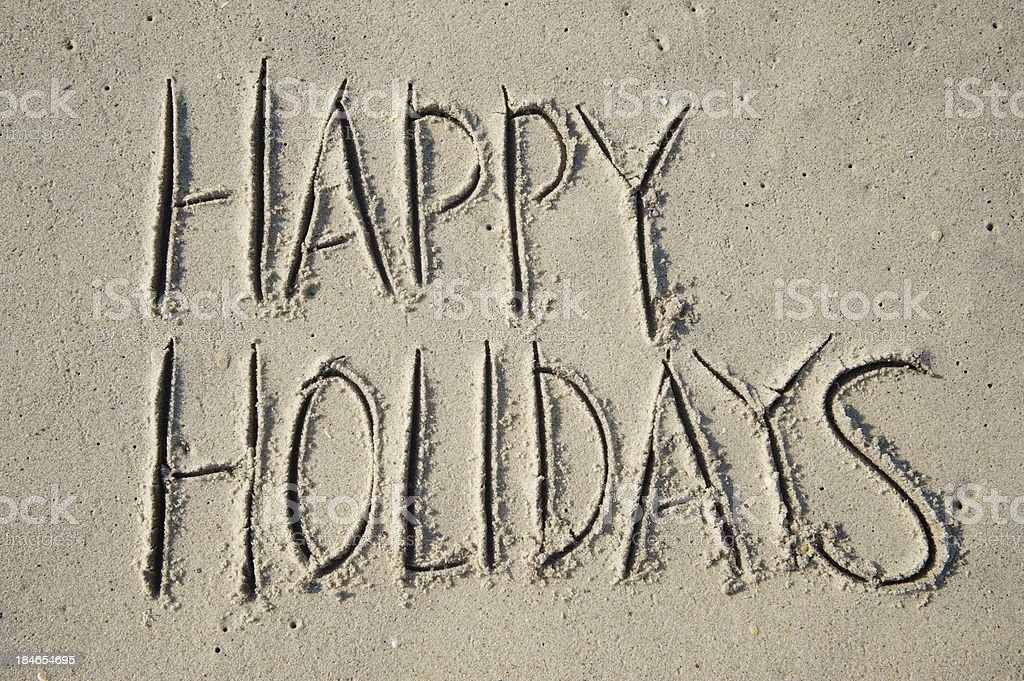 Happy Holidays Greeting Message Handwritten in Smooth Sand royalty-free stock photo