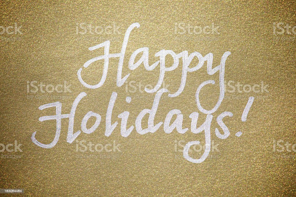 Happy Holidays Message Greeting Card Silver on Sparkly Gold Paper royalty-free stock photo