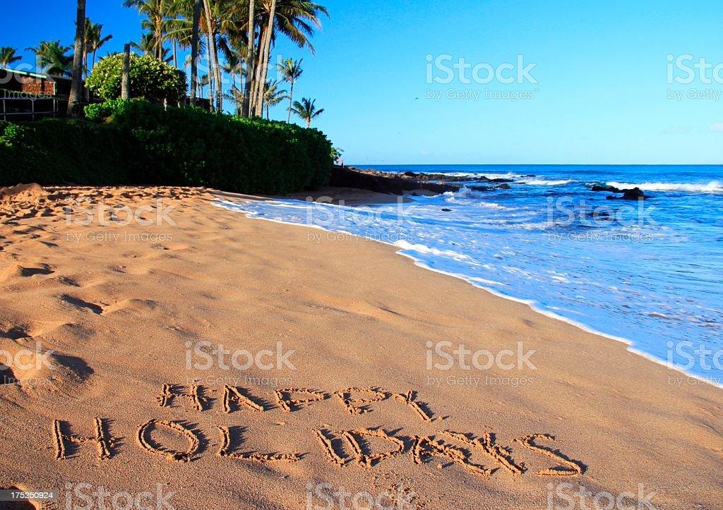 Happy Holidays written on Maui Hawaii beach sand royalty-free stock photo