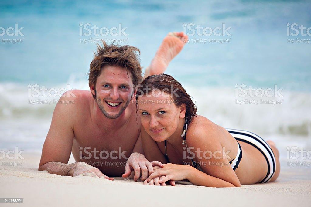 happy honeymoon couple on the beach royalty-free stock photo