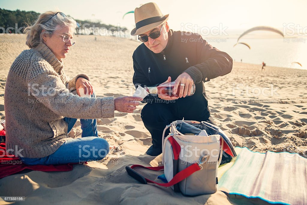 Happy hour for couple on beach in spring. stock photo
