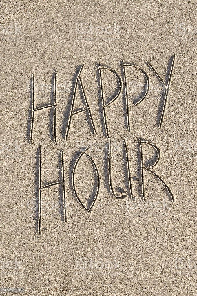 Happy Hour Message Handwritten in Clean Sand royalty-free stock photo