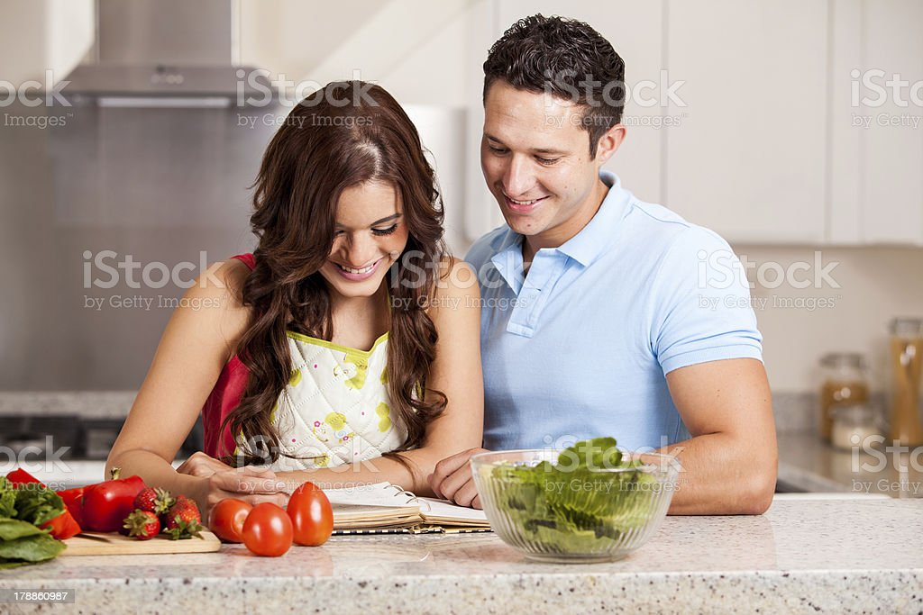 Happy housewife cooking dinner royalty-free stock photo