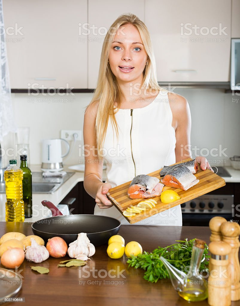 Happy housewife cooking stock photo