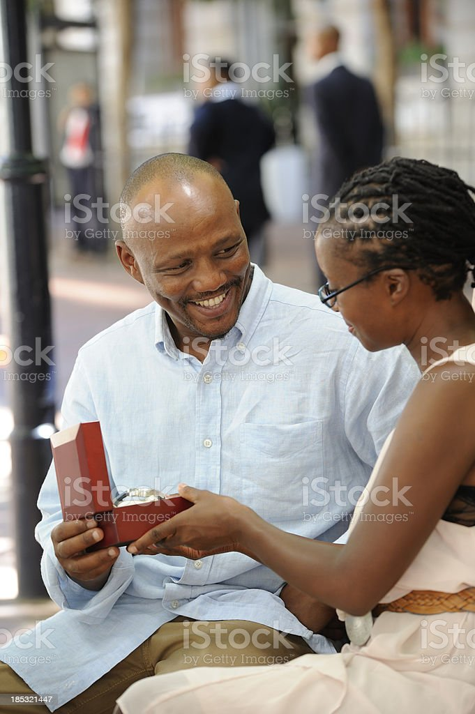 Happy husband receiving gift watch royalty-free stock photo