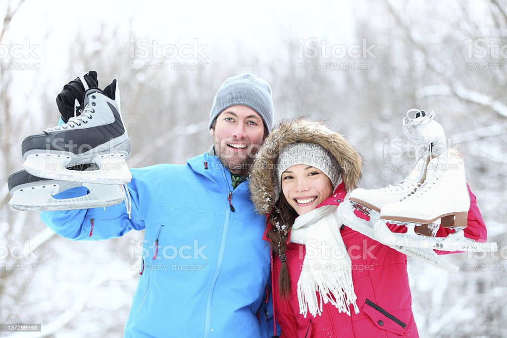 Happy ice skating winter couple stock photo