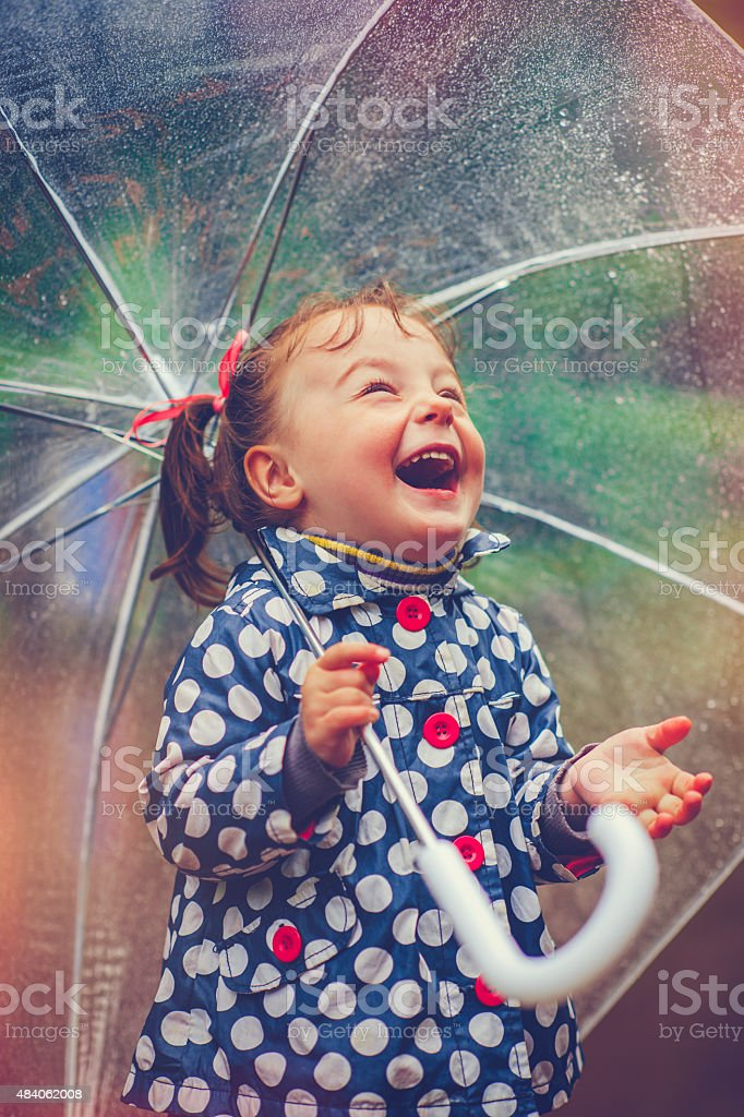 Happy in rain stock photo
