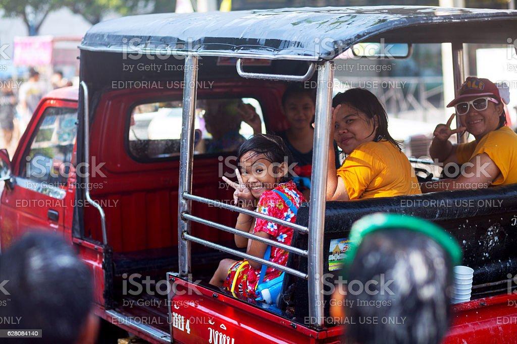 Happy in tuktuk at Songkran stock photo