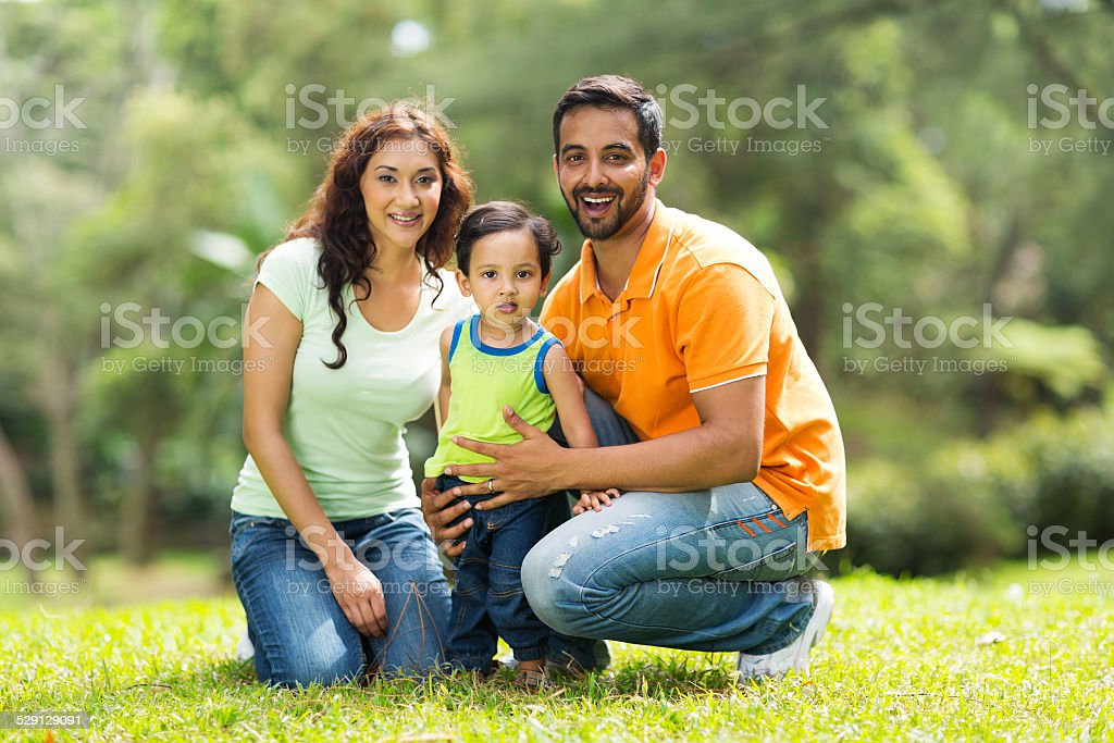 happy indian family outdoors stock photo