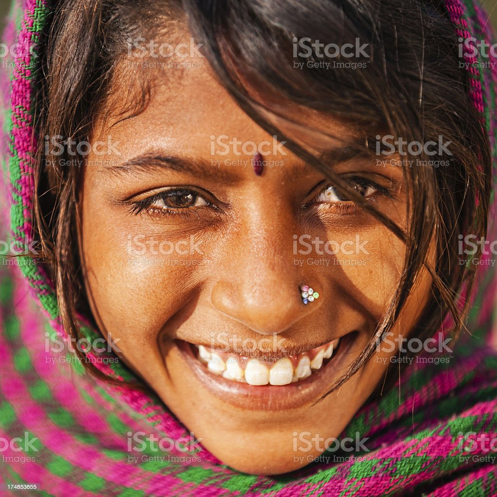 Happy Indian girl in desert village, India royalty-free stock photo