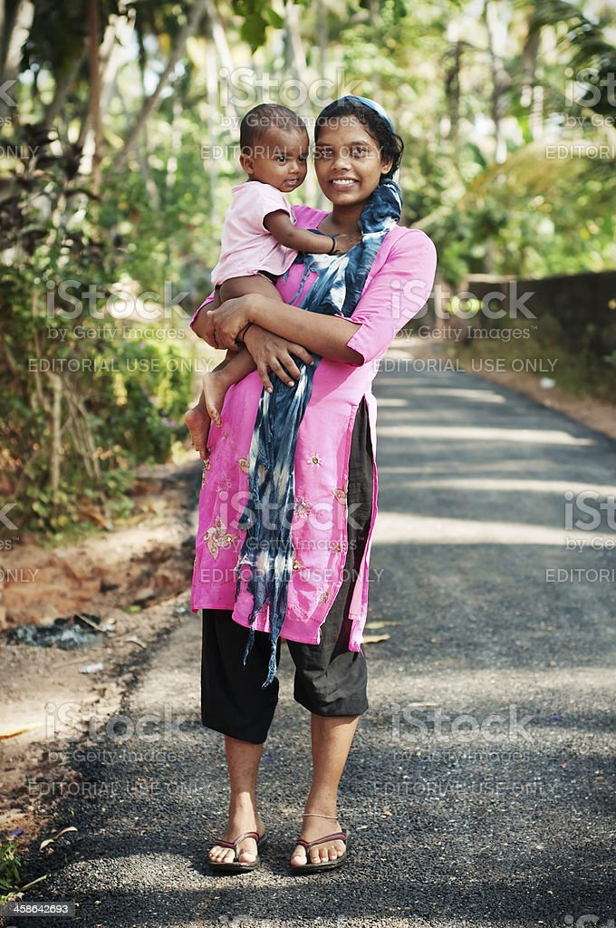 Happy indian mother with child stock photo