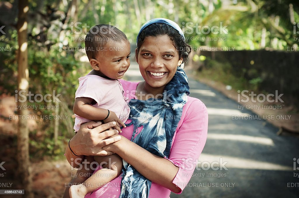 Happy Indian mother with her child. stock photo