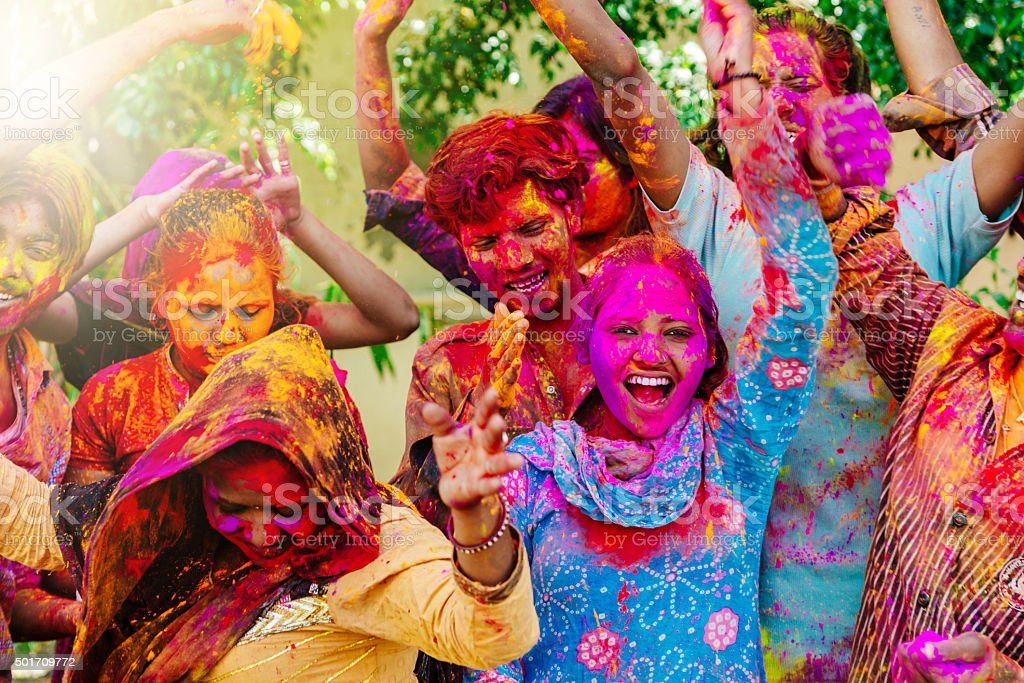 Happy indian people celebrating Holi Festival stock photo
