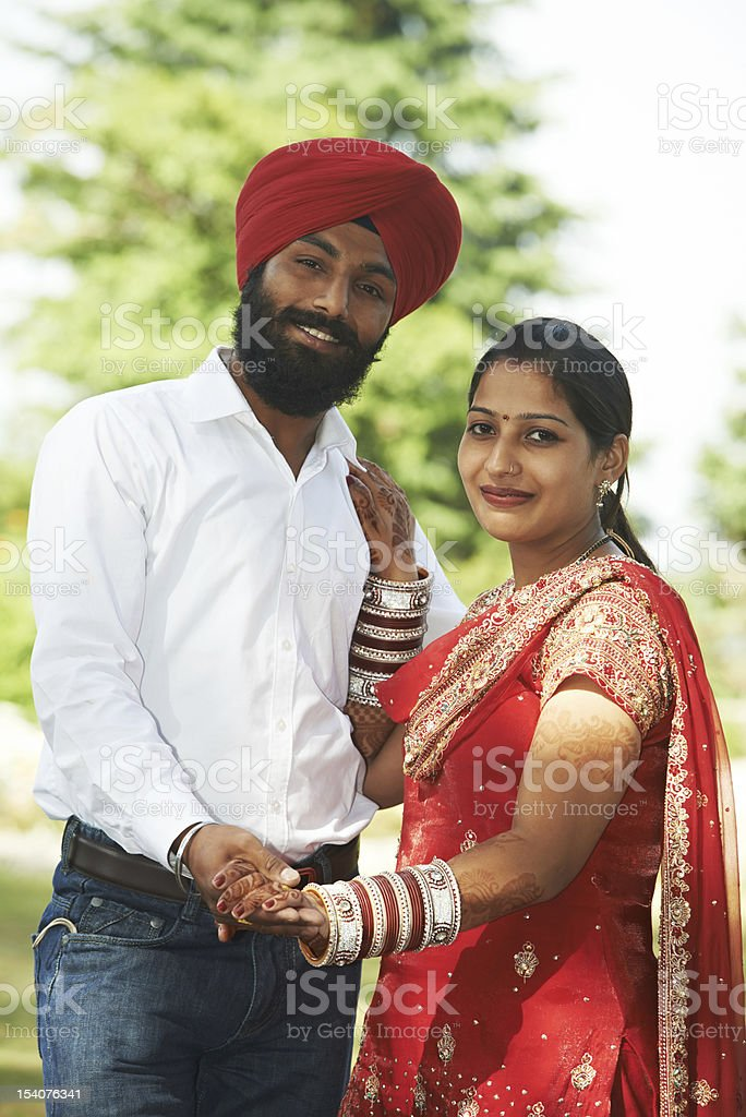 Happy indian young adult married couple stock photo