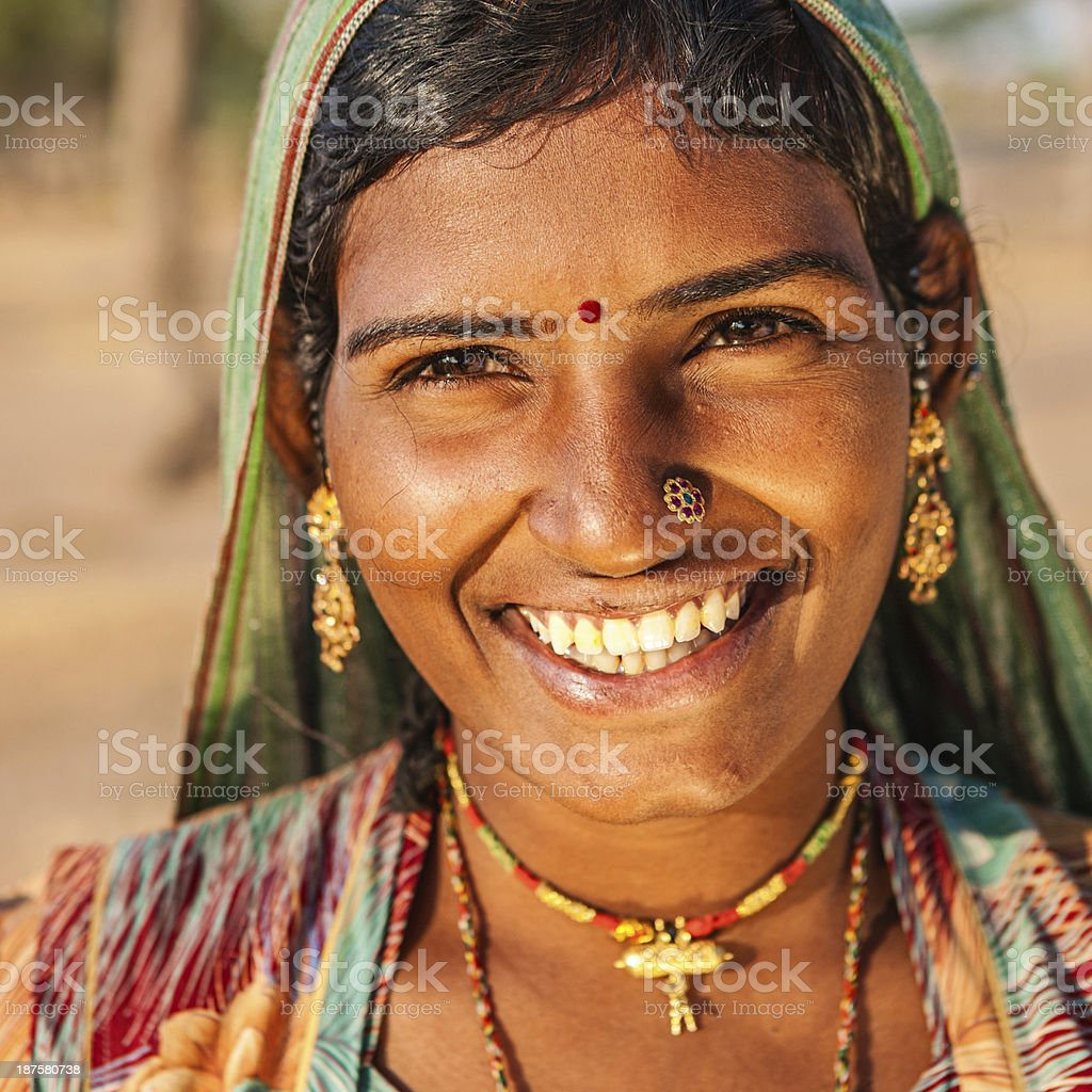 Happy Indian young woman in desert village, India royalty-free stock photo