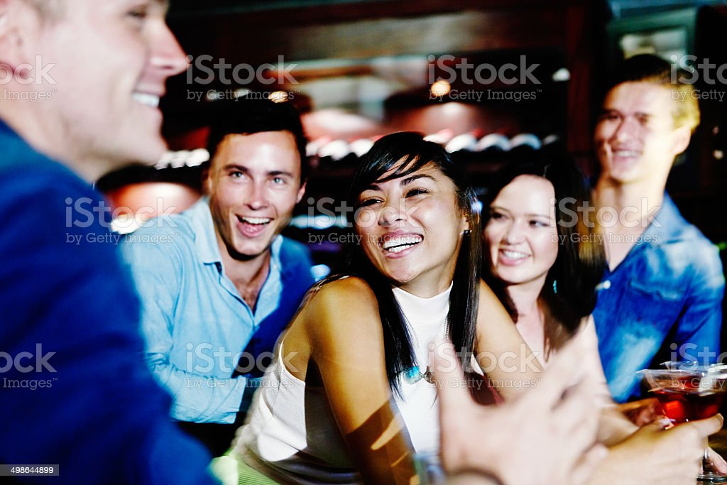 Happy interaction between friends at club bar stock photo