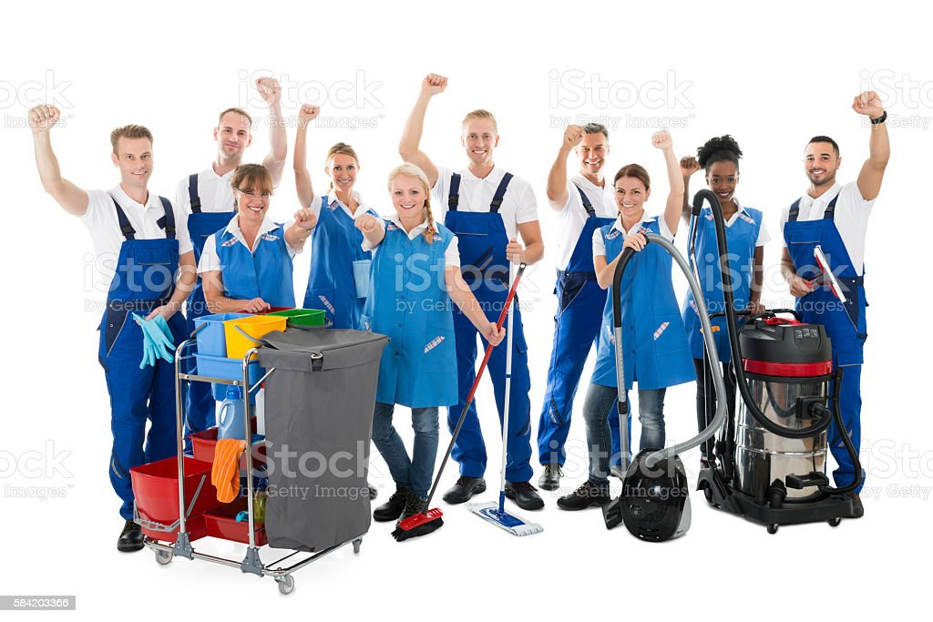 Happy Janitors With Arms Raised Holding Cleaning Equipment stock photo