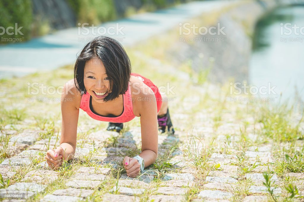 Happy Japanese Bicycle Rider Doing Yoga, Kamo River, Kyoto, Japan stock photo