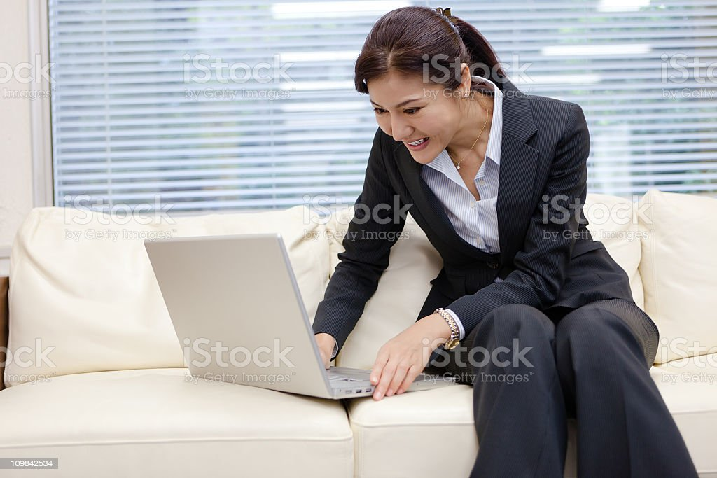Happy Japanese Businesswoman on the computer royalty-free stock photo