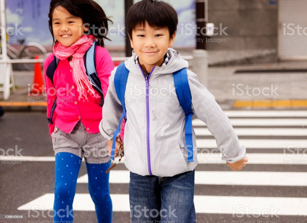 Happy Japanese Children Crossing the Street royalty-free stock photo
