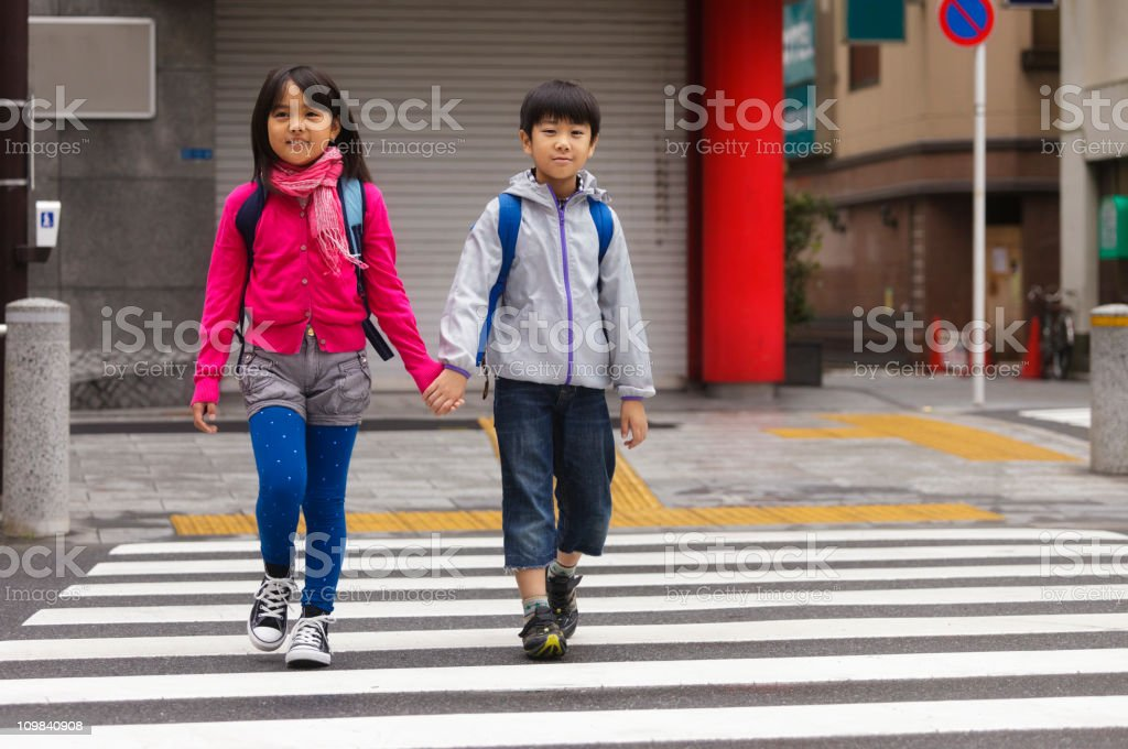 Happy Japanese Children Crossing the Street stock photo
