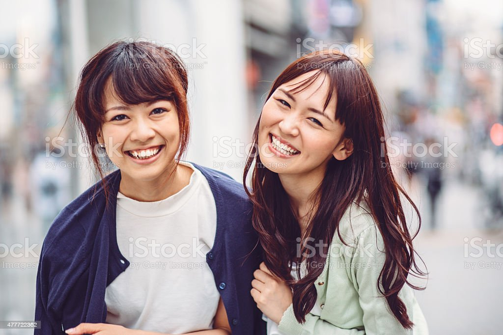 Happy japanese girl friends outdoors in Japan stock photo