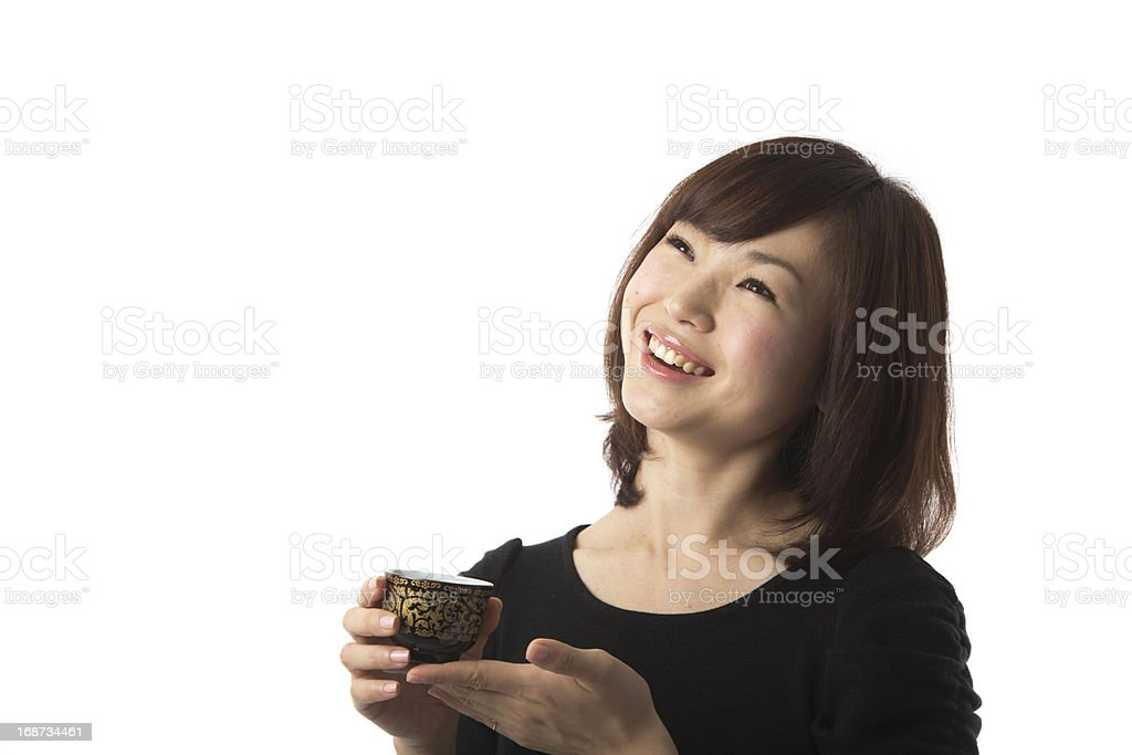 Happy Japanese Woman Holding Tea Cup royalty-free stock photo