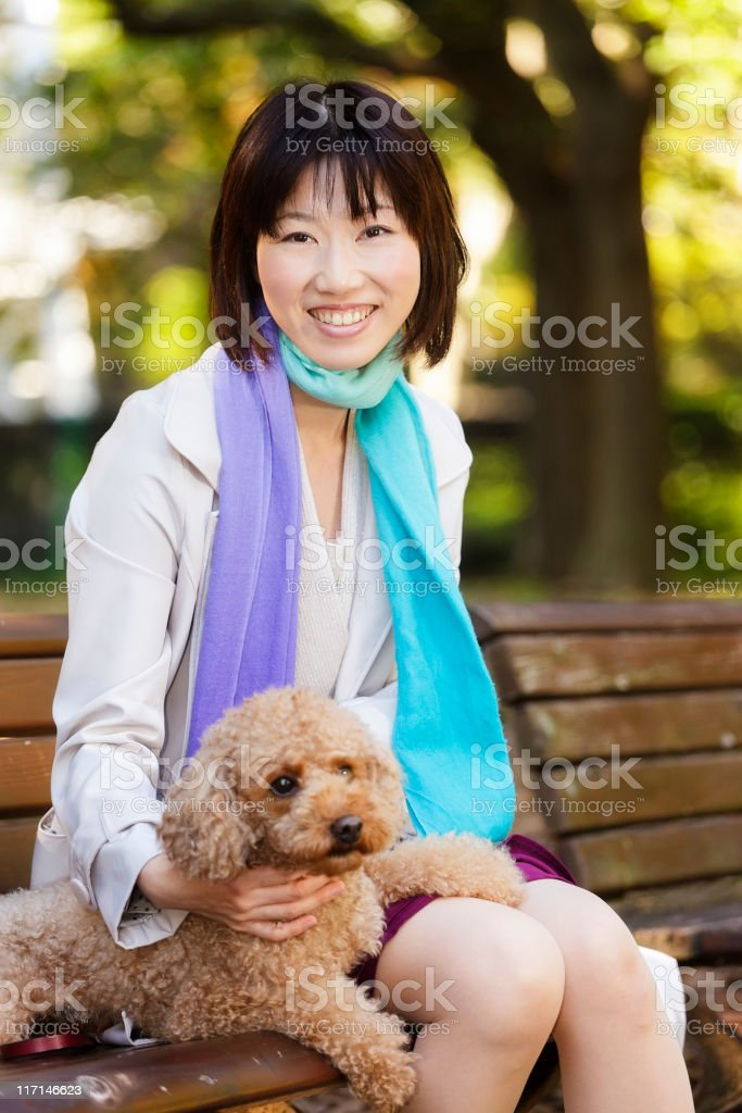 Happy Japanese Woman With Her Dog royalty-free stock photo