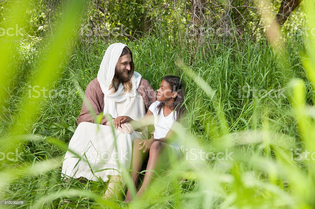 Happy Jesus Christ and Young Girl stock photo