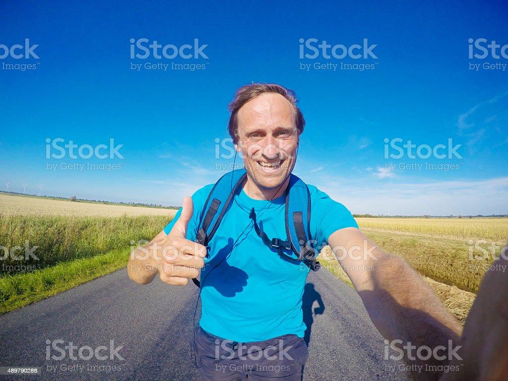 Happy jogger on tarr road, GoPro image stock photo