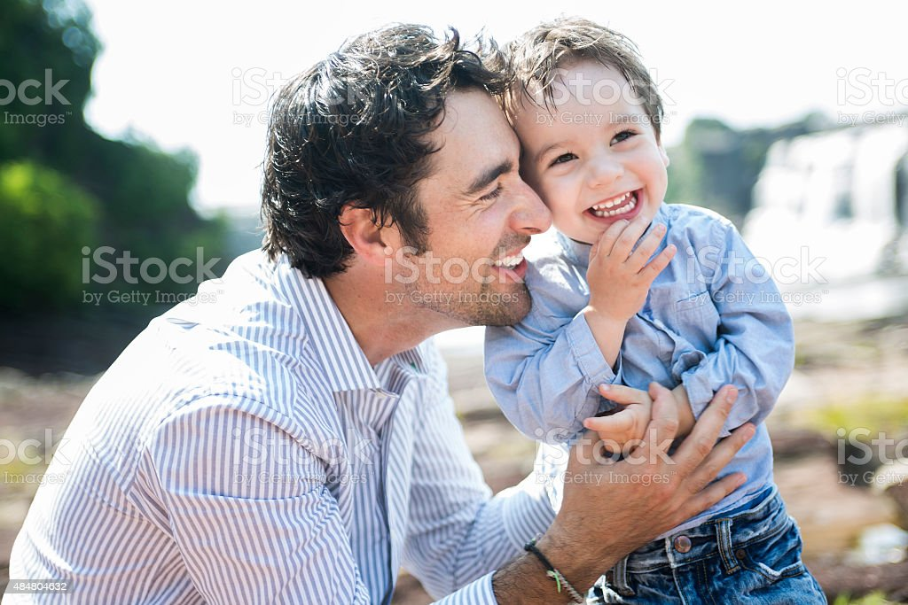 happy joyful father having fun with is child stock photo