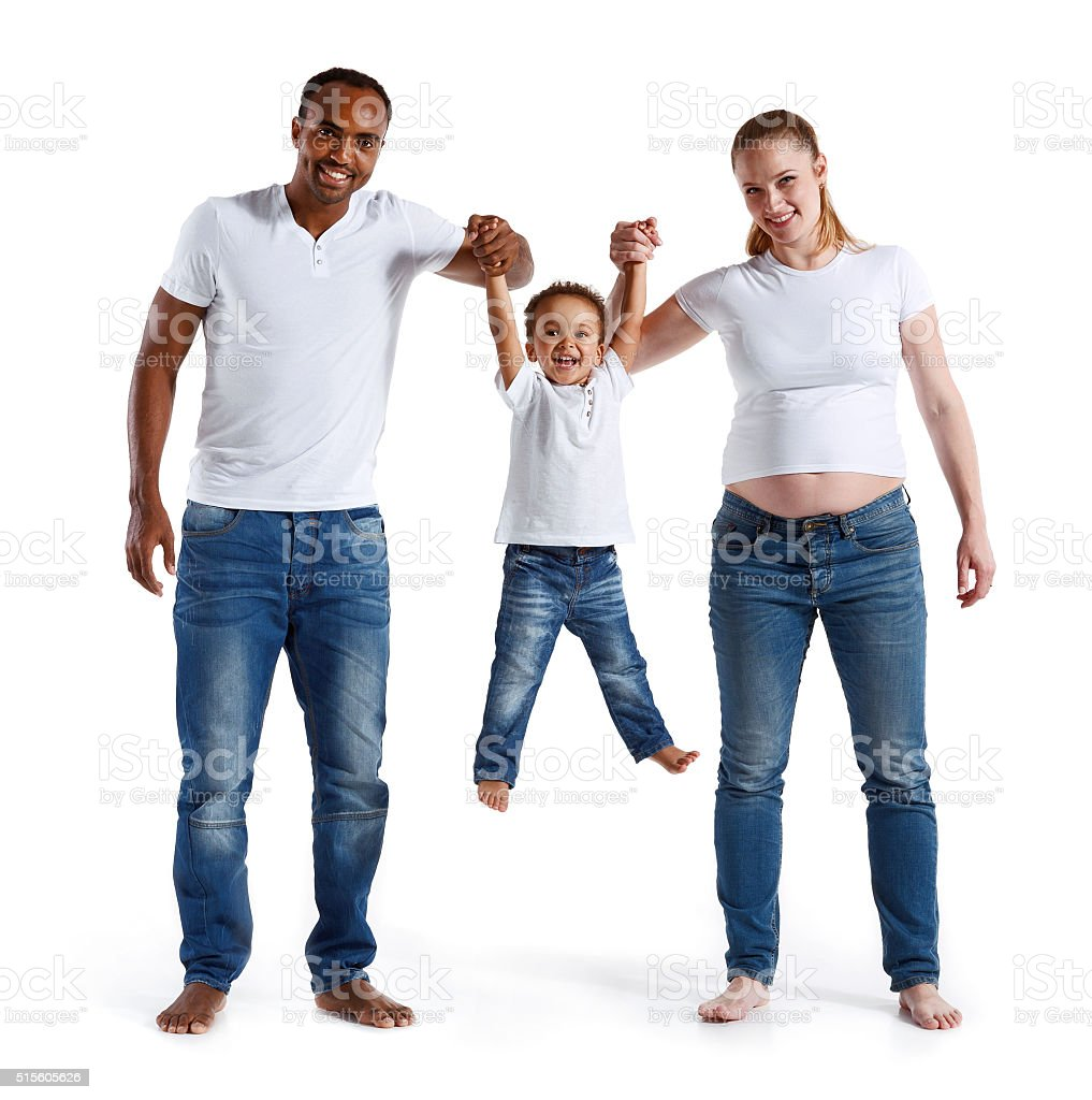 Happy joyful parents having fun with his son, family relationship. stock photo