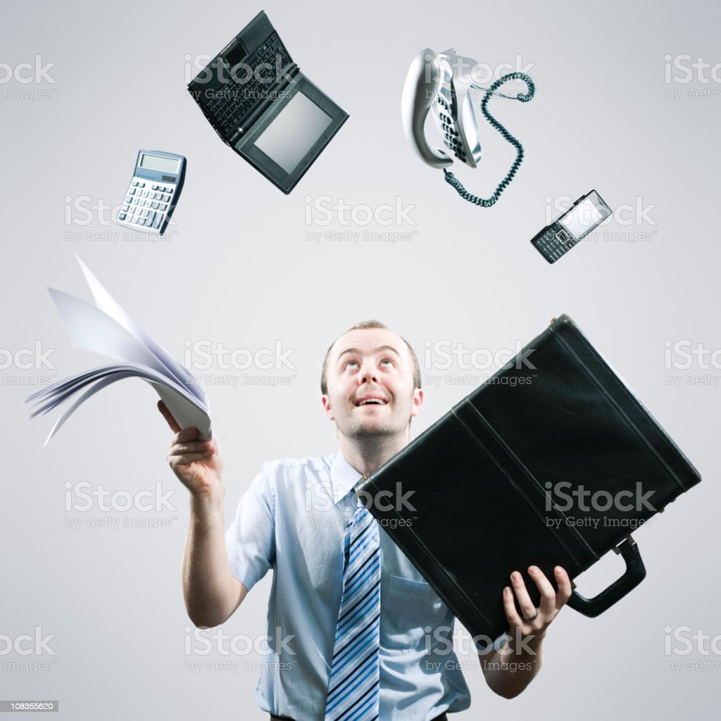 Happy Juggling Businessman stock photo