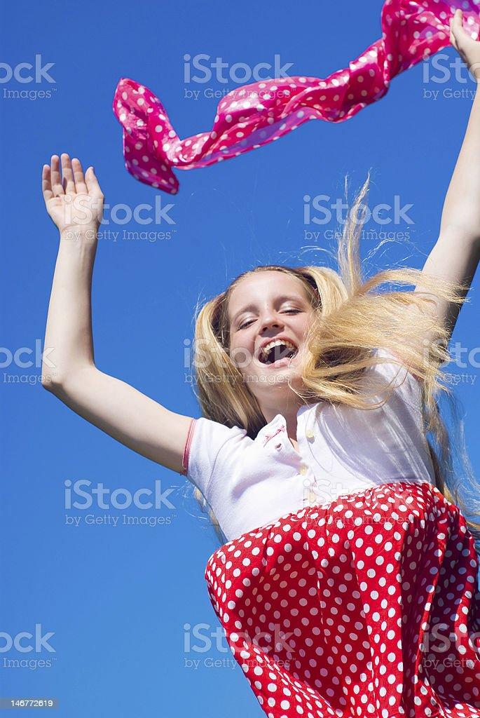 Happy jumping girl royalty-free stock photo