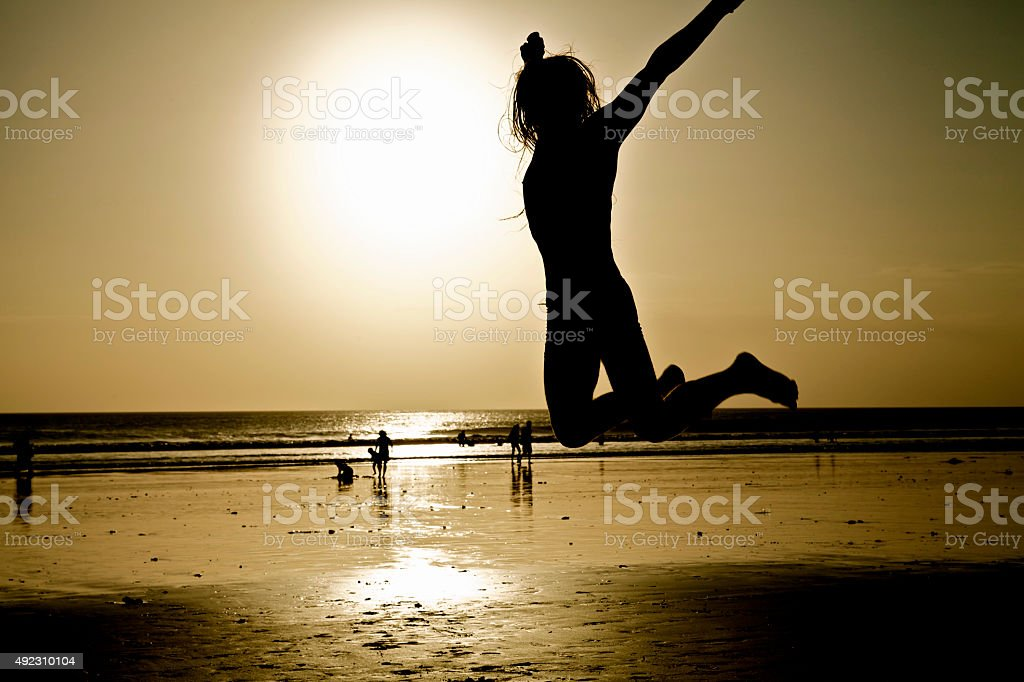 Happy jumping man on beach. Holidays. Vacations. Free time. Joy. stock photo