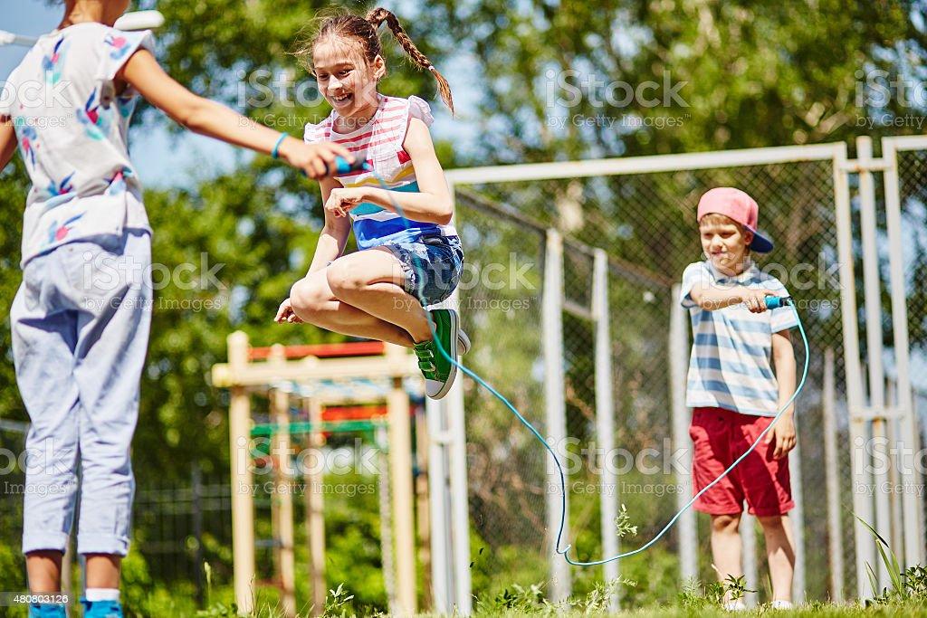 Happy jumping stock photo