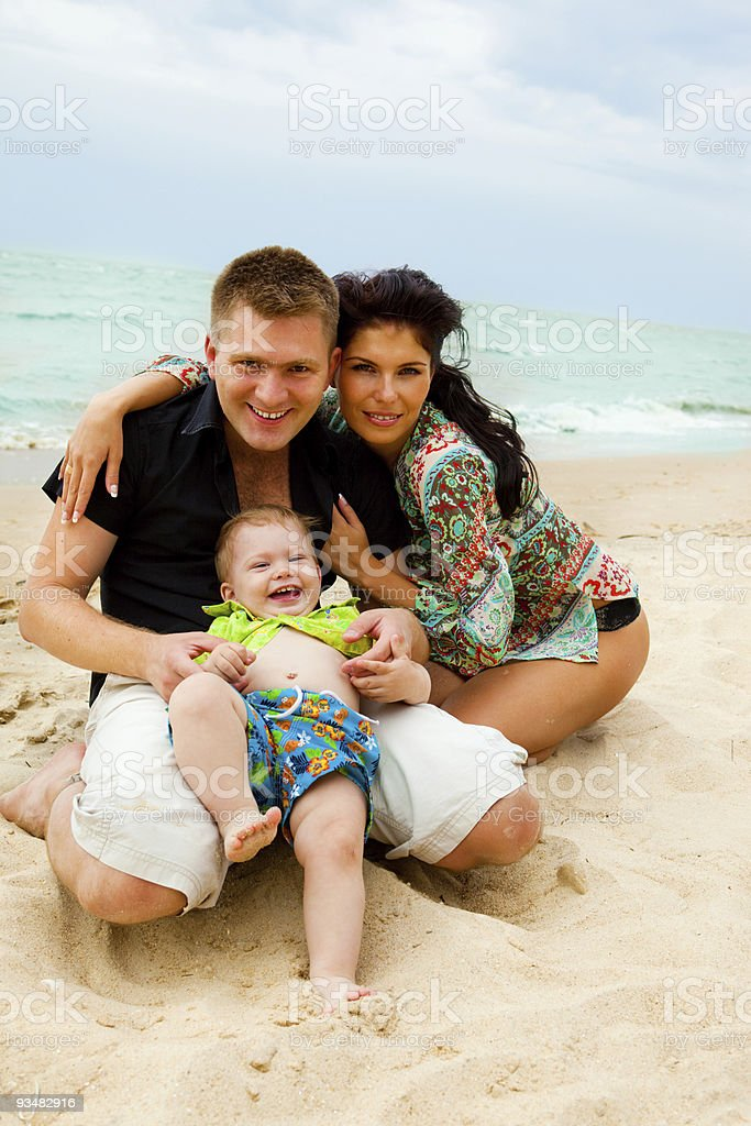 Happy kid and his parents royalty-free stock photo