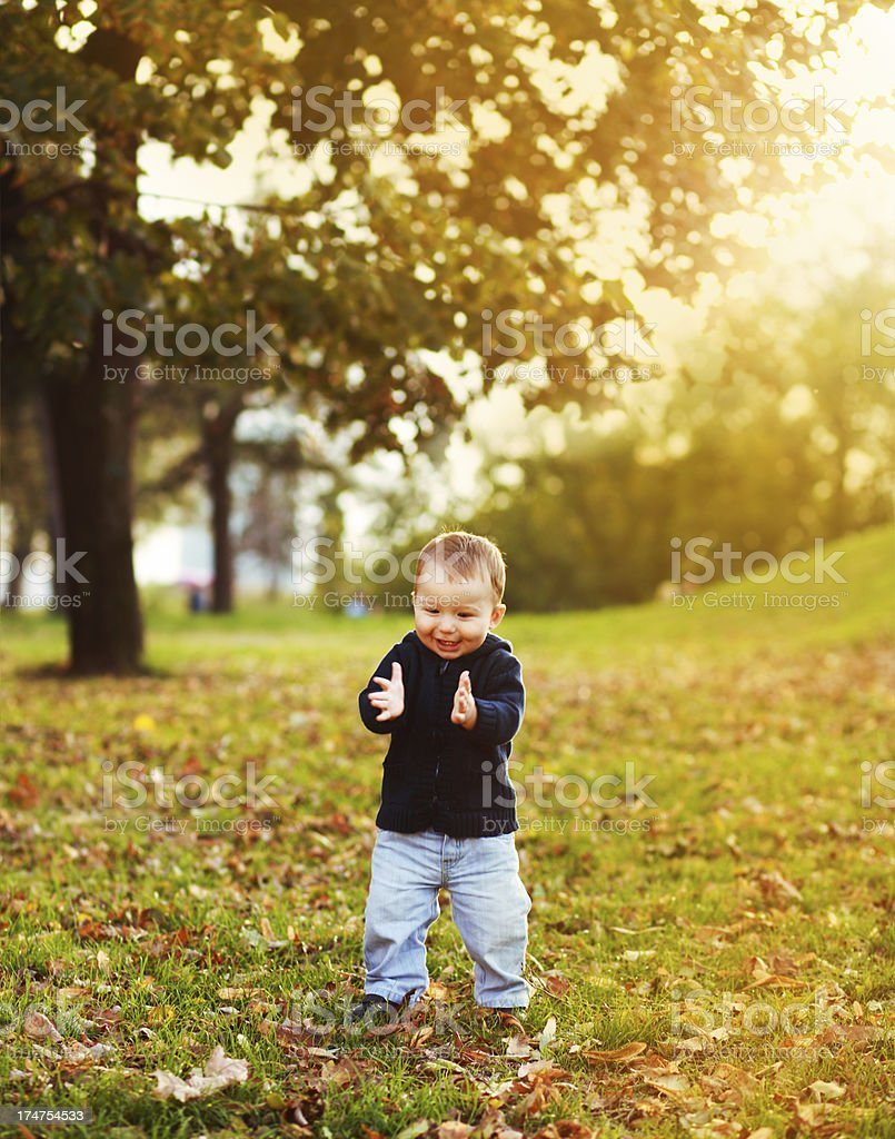Happy kid clapping hands royalty-free stock photo