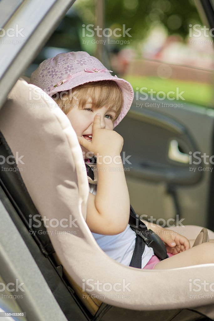 happy kid in a safety seat royalty-free stock photo