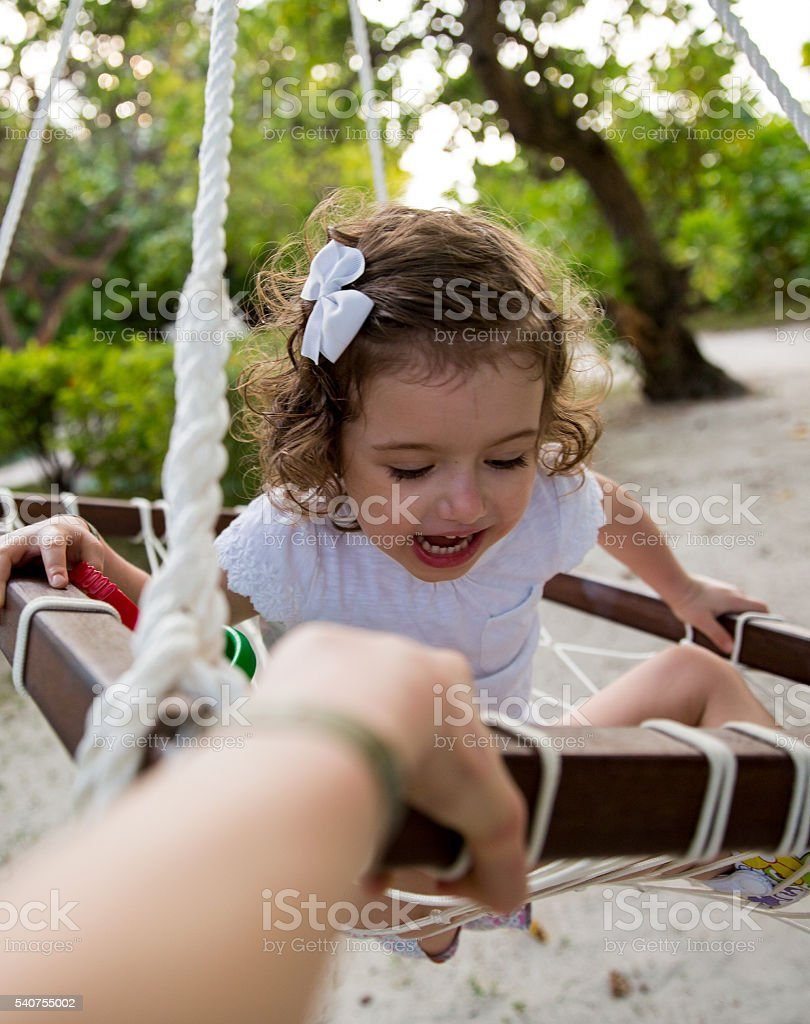 Happy kid in a swing stock photo