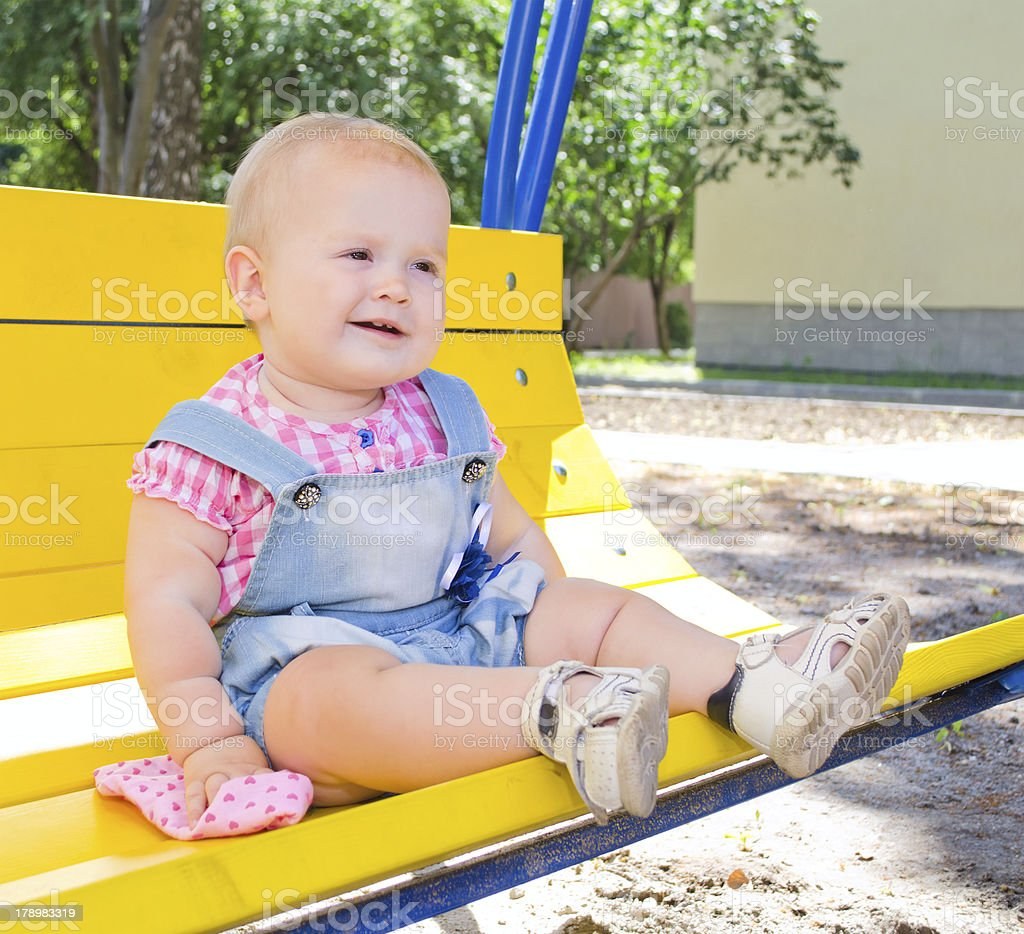 happy kid on a swing stock photo