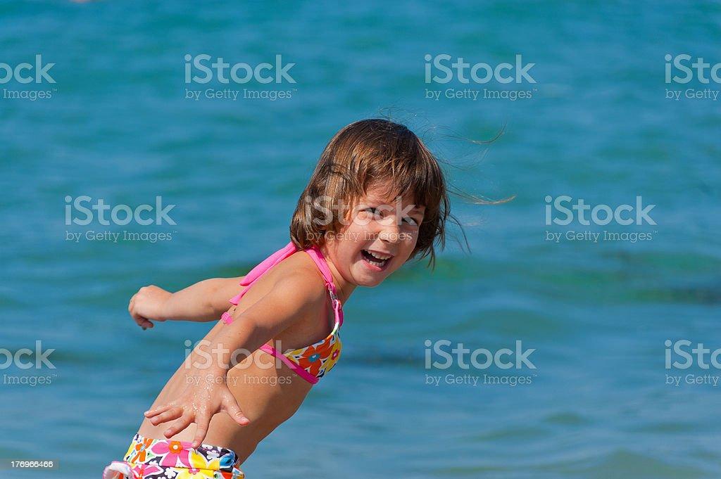 Happy kid on beach vacation stock photo