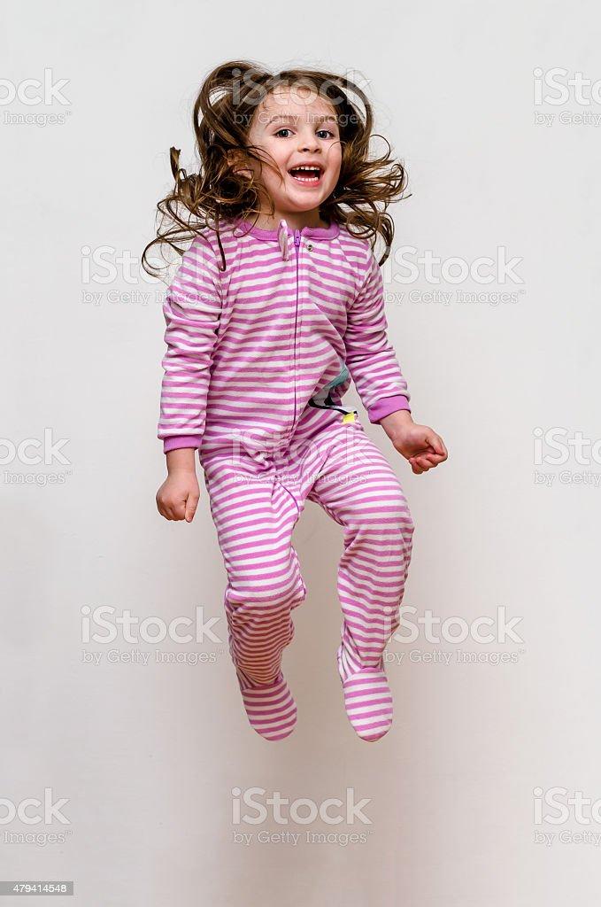 Happy Kid Pajama Jumping stock photo