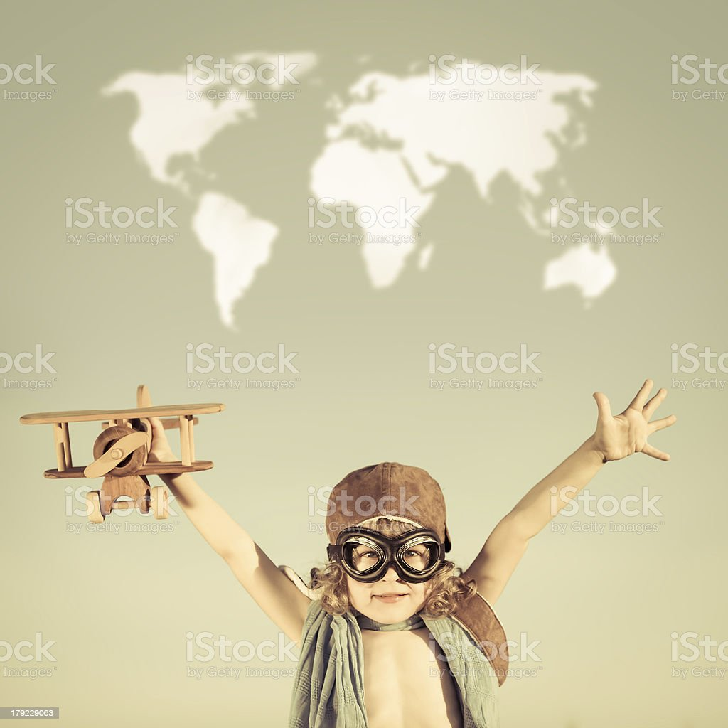 Happy kid playing with toy airplane royalty-free stock photo