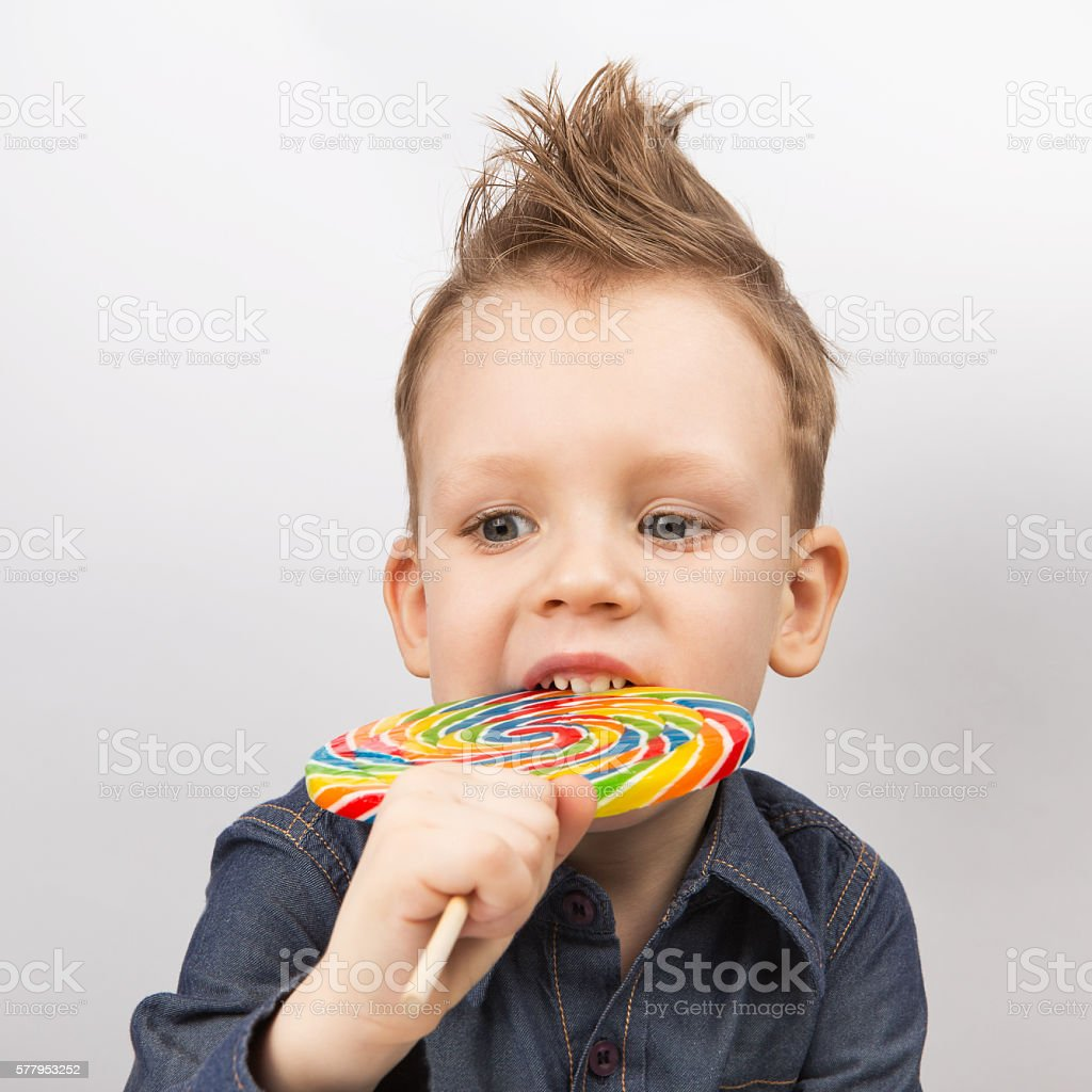 Happy kid with a big candy stock photo