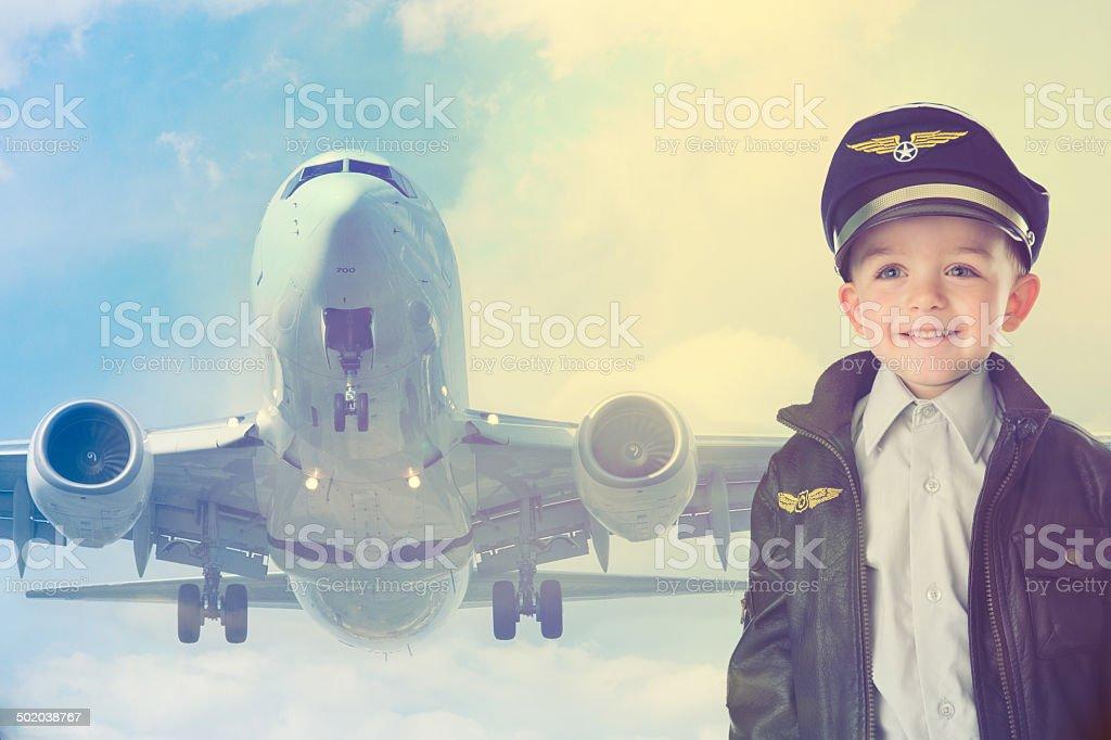 Happy kid with airplane stock photo