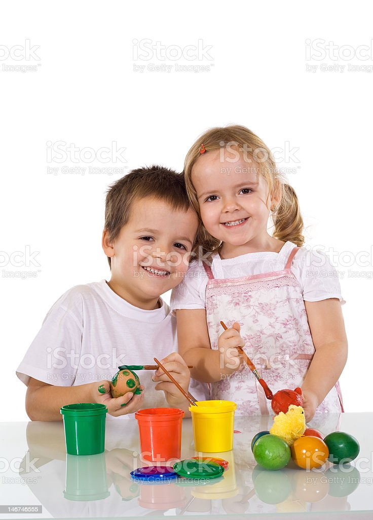 Happy kids coloring easter eggs royalty-free stock photo