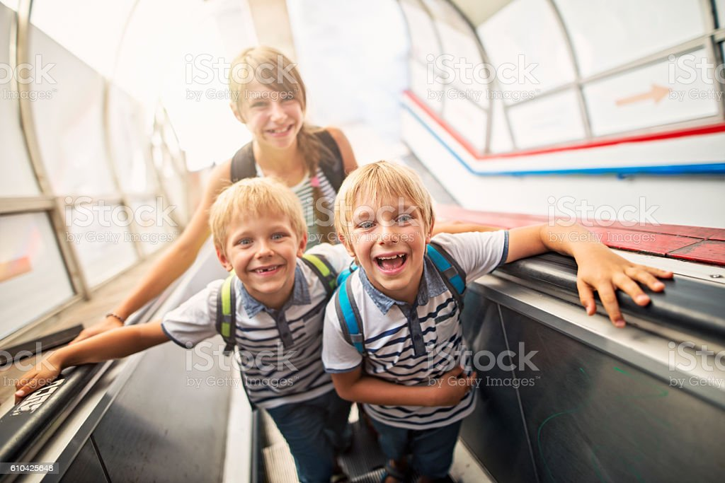 Happy Kids in Rome travelling on escalator stock photo