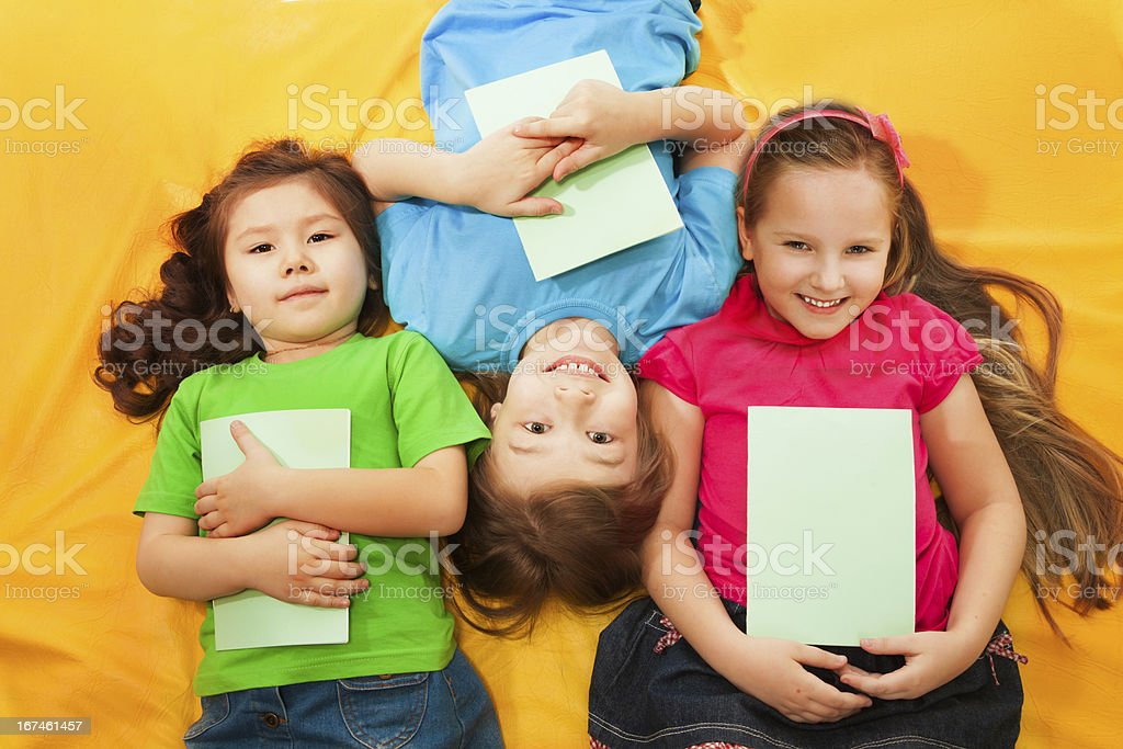 Happy kids laying together royalty-free stock photo