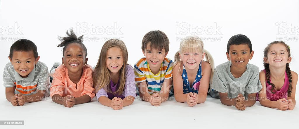 Happy Kids Lying in a Row stock photo